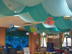 Classroom ceiling, hallway decorating, under the sea theme, under the sea party, Classroom Ceiling Decorations, Classroom Decor Themes, Beach Decorations, Classroom Ideas, Under The Sea Theme, Under The Sea Party, Rainbow Library, Paper Bowls, Ocean Themes