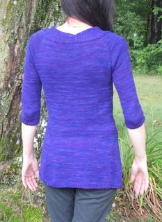 Ready or Knot is a nearly seamless cardigan worked from the top-down. The knotted upper collar adds a twist to the open style and makes the raglan construction appear to be more of a set-in sleeve. A provisional cast on is used to add stitches below the knot—these stitches are picked up once the bodice is complete, the knotted collar is worked from them, and then sewn into place along the upper neckline. Note that the pattern does not include a tutorial for the provisional cast on itself.