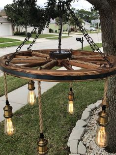 Wagon Wheel Chandelier with vintage bulbs (Brown Chain) Wagon Wheel Light, Wagon Wheel Decor, Wagon Wheel Chandelier, Jar Chandelier, Mason Jar Lighting, Rustic Lighting, Vintage Lighting, Outdoor Lighting, Outdoor Decor
