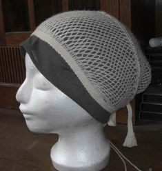sprang hairnet with tablet-woven band. By Andrea Wagner