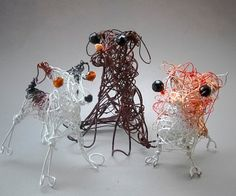This designer does the most whimsical dog portraits made of wire...don't know why I love them so much but I do.