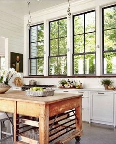 I love this bank of windows with black mullions. I'd sacrifice upper cabinets for all the light that'd pour into the kitchen.