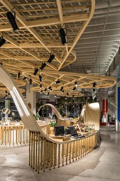 Image 14 of 47 from gallery of Colletive Space + Manual House / Fabio Galeazzo. Photograph by Fran Parente Shopping Mall Interior, Changing Spaces, Bamboo Wall, Old Wall, Booth Design, Best Wordpress Themes, Ceiling Design, Retail Design, Household Items