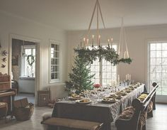 """Christmas Table in the great room. I wonder if a modular table could be put up and taken down in this room. Ordinarily the couch and chairs could """"float"""" in the room, but then they are bushed aside to make room for the event table. Bohemian Christmas, Swedish Christmas, Noel Christmas, Scandinavian Christmas, Rustic Christmas, Nontraditional Christmas Dinner, Simple Christmas, Christmas Table Settings, Christmas Decorations"""