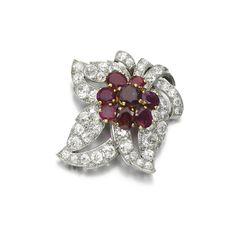 Ruby and diamond brooch, Cartier, 1950s Designed as a leaf, set with cushion-shaped and circular-cut diamonds, accented with a cluster of variously cut rubies, signed Cartier.