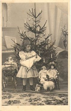 A little girl and her dolls celebrate