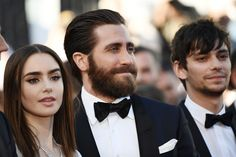 Lily Collins Photos Photos - (From L) British actress Lily Collins, US actor Jake Gyllenhaal and Canadian actor Devon Bostick pose as they arrive on May 19, 2017 for the screening of the film 'Okja' at the 70th edition of the Cannes Film Festival in Cannes, southern France.  / AFP PHOTO / Anne-Christine POUJOULAT - 'Okja' Red Carpet Arrivals - The 70th Annual Cannes Film Festival