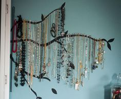 tree limb vinyl + clear thumbtacks + jewelry = cool jewelry organization that looks like necklaces hanging from the branches! @Sabrina Nauman Peterson