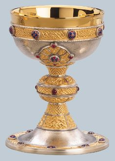 """""""The Ardagh"""", a version of the original Celtic chalice of the VIII century. 24 Karat goldplate contrasting on antique Silver Plate. Adorned with fire enamel cabouchons and garnet stones. 7 3/4"""" ht., 5 1/8"""" cup, 20 oz. capacity, 7"""" scale paten diameter. $7995 - $8495"""