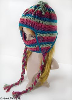 Sledding Hat. Love the removable face mask. And the top has a drawstring so you could wear a ponytail on top of your head and let it poke out. Pattern costs $3 if you don't want to try to guess.
