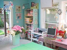 love the color in this sewing room