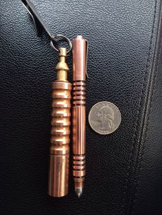 Rick Hinderer Investigator Pen (Copper) & Prometheus QR flashlight (Raw Copper).