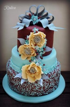 So unusual, so beautiful wedding cake.  Robin's egg blue and aubergine tiers with yellow flowers.
