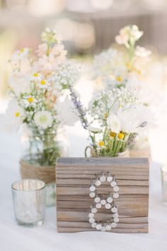 Unique and creative #wedding table number ideas. To see more: http://www.modwedding.com/2013/09/22/unique-creative-wedding-table-number-ideas/ #wedding_table_number_ideas #wedding_centerpiece
