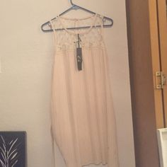 L dress from ModCloth, tags on, never worn Size L dress from ModCloth, never been worn, tags on. Cream colored ModCloth Dresses Midi