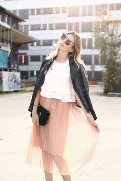 pleated skirt and leather Jacket