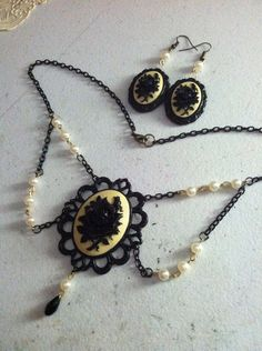 The Victorian black rose necklace and by EleganceOfTheHeart