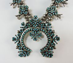 The natural blue turquoise is cut into 378 individual cabs which are smaller than grains of rice, and each is bezel set!