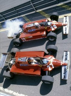 Gilles Villeneuve and Didier Pironi side by side in the pit lane aboard their Scuderia Ferrari Ferrari before the start of the San Marino Grand Prix on May 1981 at the Autodromo Enzo e Dino Ferrari in Imola, San Marino. Ferrari F1, Ferrari Scuderia, Ferrari Racing, F1 Racing, Drag Racing, Escuderias F1, San Marino Grand Prix, F12 Berlinetta, Gilles Villeneuve