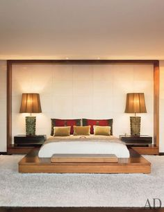 """""""I wanted to be able to curl up in it,"""" Aniston says of the master bedroom. Shadley designed the platform bed, which has a motorized television lift topped with Rogers & Goffigon fabric. Of the shag rug, he says, """"It's wool and silk and very lush."""" Calvin silk is on the lampshades."""