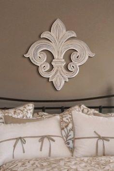 love this simple fleur de lis for behind a bed