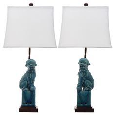 Evoke Eastern-inspired elegance in your living room or den with this eye-catching ceramic table lamp, showcasing a Foo dog design in blue.  ...