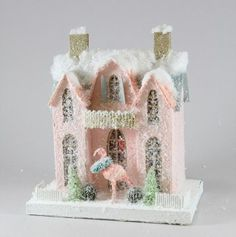 """A fun rendition of a vintage Christmas putz house. - 9"""" L x 6"""" W x 10""""H. - Pressed paper, mica, glitter, batting, and bottle brush. - Imported."""