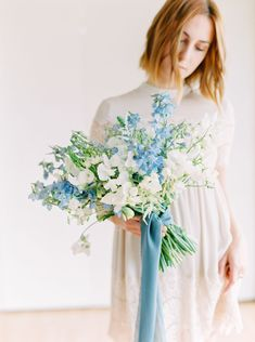 Wedding film photography image of a Bride with white and green bouquet with blue sweet peas and blue ribbons, Cavin Elizabeth Photography and Organic Flora Blue Wedding Flowers, Diy Wedding Bouquet, Wedding Flower Arrangements, Bride Bouquets, Floral Wedding, Wedding Centerpieces, Floral Arrangements, Wedding Garlands, Tall Centerpiece