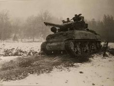 January 3rd 1945 this M4A1 (76) part of the reserve of 2nd Armored Division move up to the front were they will be put into action against the Germans. In the La Fosse sector of Belgium . It is worth noting that there is a Fosse in both Liege and Namur in Belgium. And 2nd Armored were active in both areas, but going on the date we think is could be Liege .