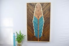 Bohemian turquoise feather wood wall art for your peaceful living space! https://www.etsy.com/listing/290757631/reclaimed-wood-wall-art-hanging-large