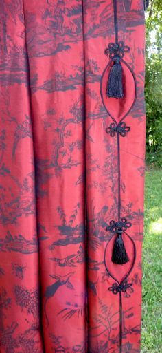 The fabric, the frogs with tassels, all this exquisite detailing is what makes custom draperies so special.