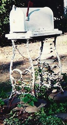 mailbox mounted on an antique sewing machine base - so cute!