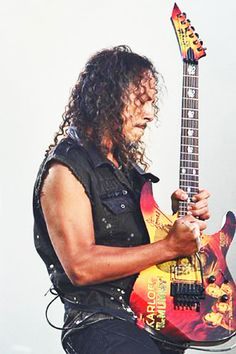 "Kirk, lead guitarist for Metallica, plays his signature ESP Karloff  ""The Mummy"" guitar. Kirk is a super fit vegetarian who is also an expert surfer."