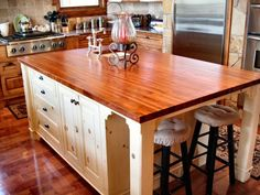 Like the contrasts here - light wood cabinetry, darker wood island countertop, dark wood floors