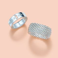 A sleek band or textured mesh? Tiffany Locks wide ring with diamonds and Tiffany Somerset™ ring in sterling silver.