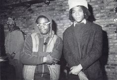 The son of a successful businessman, Basquiat nonetheless cultivated an image of untutored street graffitist. But the streets he strategically chose for his SAMO tag were in Soho and the East Village. Here, Basquiat (right) with a fellow hip-hopper, 1982