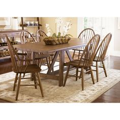 This country style table is a tasteful and elegant way to bring family and friends together. Made of solid oak, this piece will sit in your dining area for years to come and gain and develop character.