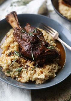 Sink your teeth into this delicious and elegant Braised Lamb Shanks Recipe with Parmesan Risotto that is sure to be a family favorite!