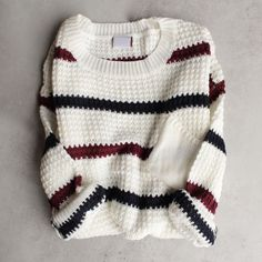 Super soft vintage inspired boyfriend sweater featuring an olive and burgundy striped design over a beige base, open knits, long sleeves, and an oversize fit. - imported