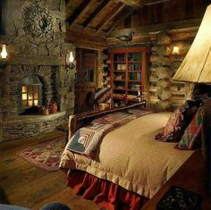Log Cabin bedroom with stone fireplace