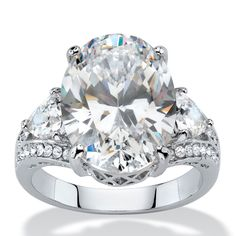 Seta Jewelry Tcw Oval And Trilliant-cut White Cubic Zirconia Bridal Engagement Anniversary Ring. Overstock Jewelry, Affordable Rings, Cubic Zirconia Engagement Rings, Palm Beach Jewelry, Bridal Rings, Anniversary Rings, Metal Jewelry, Crystals, Center Stage