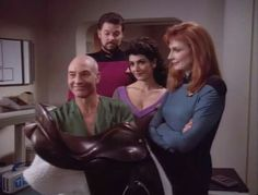 Picard, Riker, Deanna, and Beverly