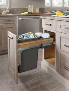 Don't let any corner of your kitchen go to waste. Martha demonstrates smart ways to make the most of under-utilized storage spaces—like those under the sink, under the kitchen island, and above the fridge.
