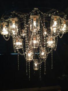20 amazingly pretty ways to use string lights turn on the lights 30 wagon wheel mason jar chandelier aloadofball Image collections