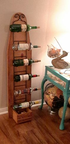 IRONING BOARD WINE RACK- TOWEL HOLDER. REPURPOSED!