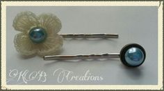 Bobby pins with blue button centers