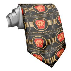Pennsylvania Railroad Logo, Black & Gold Neck Ties -SOLD- The Pennsylvania Railroad was the largest railroad by traffic and revenue in the US throughout its 20th-century existence and was at one time the largest publicly traded corporation in the world.
