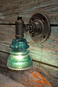 glass insulator wall sconce -   Will make these to hang above our bar top :)