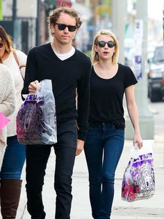 Emma Roberts and her photographer pal Tyler Shields were matching in black tops, dark jeans and, of course, wayfarers!