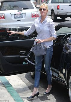 Classy: Melanie made her way out of her luxury vehicle in blue skinny jeans and a white bu...